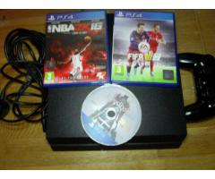 Sony Playstation 4 with wireless controller and 3 Games