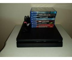 For sale Sony PlayStation 4 (PS4) 500GB + 8 Games.